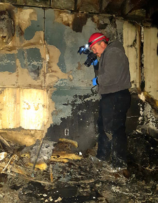 Randy Schield at work investigation the cause of the fire.